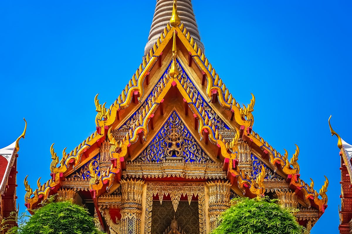 ornate golden triangular roof of a buddhist PUUMVCK e1551008492323 - Temples