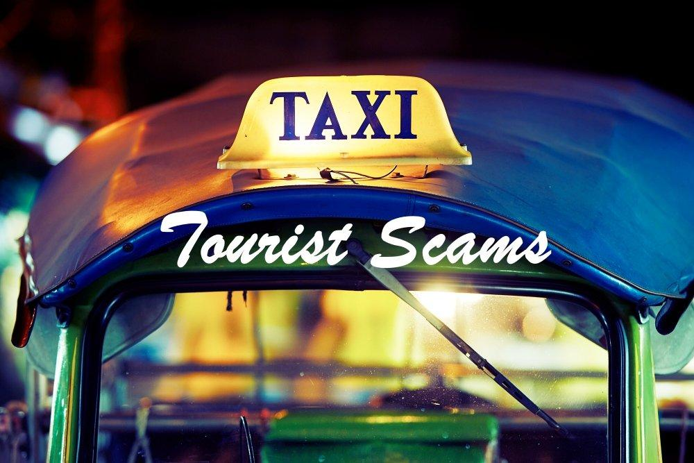tuk tuk taxi sign PE53DZG - Tourist Scams